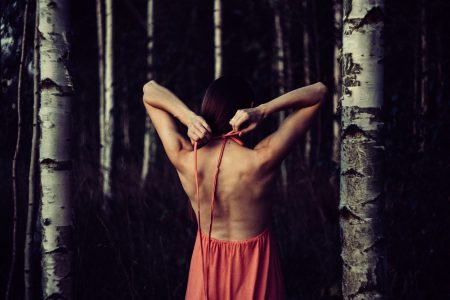 Backless dress in the woods
