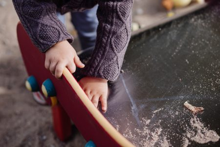 Child cleaning the slide