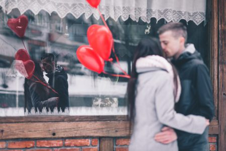 A couple with heart shape baloons