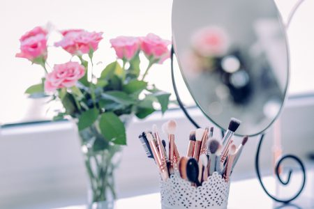 Makeup brushes and roses