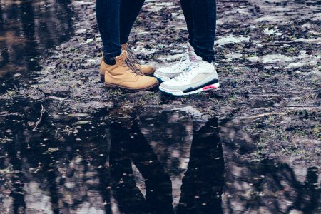 A couple reflection in a puddle