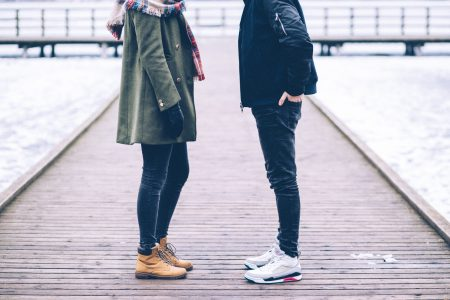 Two people standing on the pier