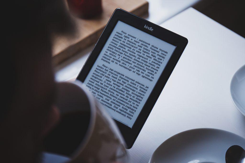 Reading on Kindle - free stock photo