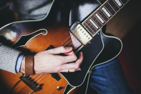 Playing guitar – front shot - free stock photo