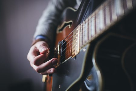 Playing guitar – side shot - free stock photo