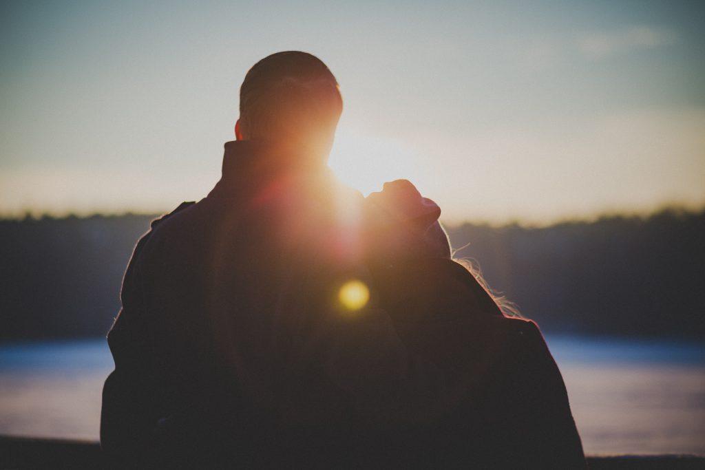 Couple watching sunset - free stock photo