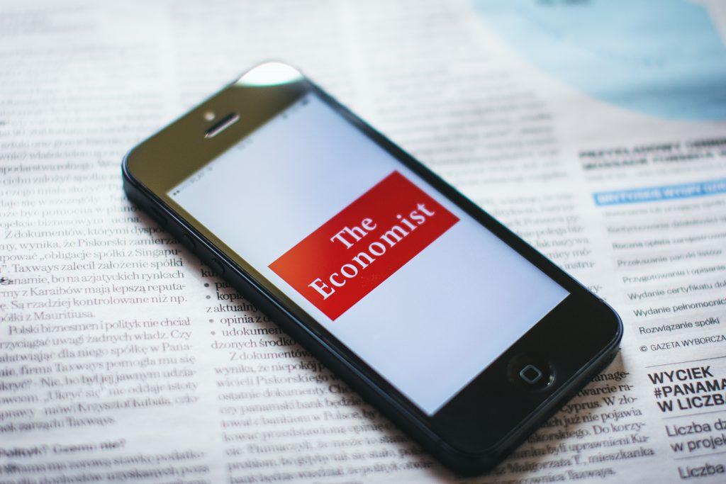 Phone on newspaper - free stock photo