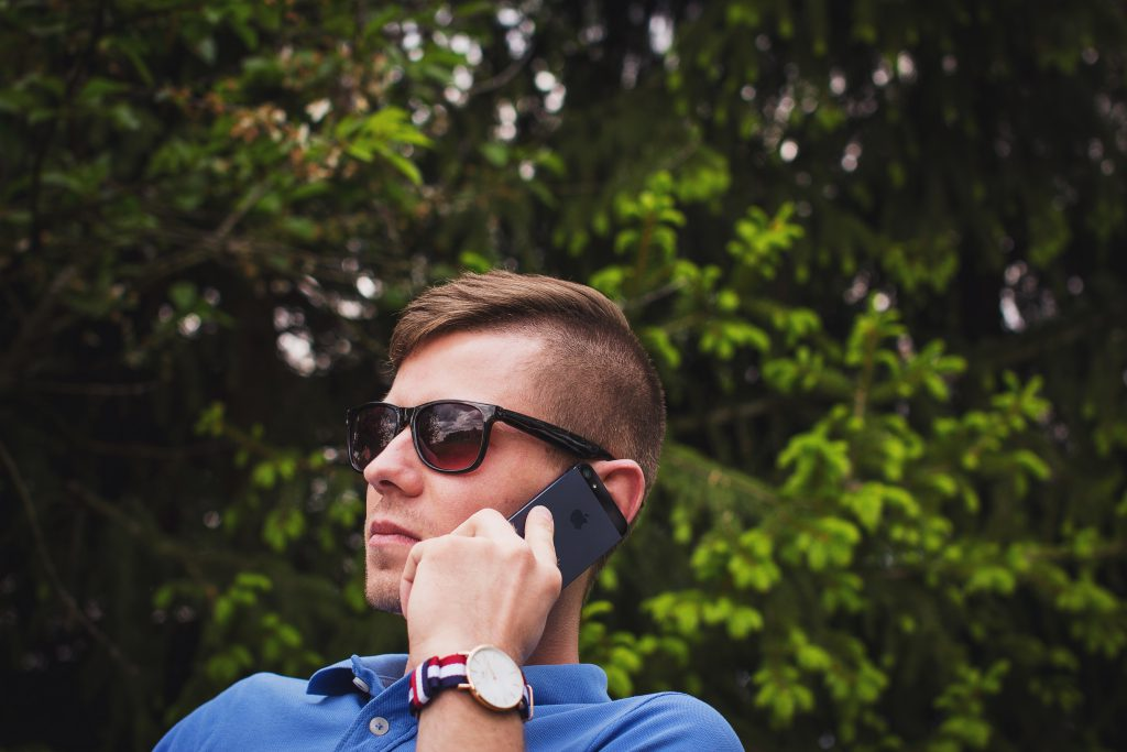 Young man talking on the phone - free stock photo