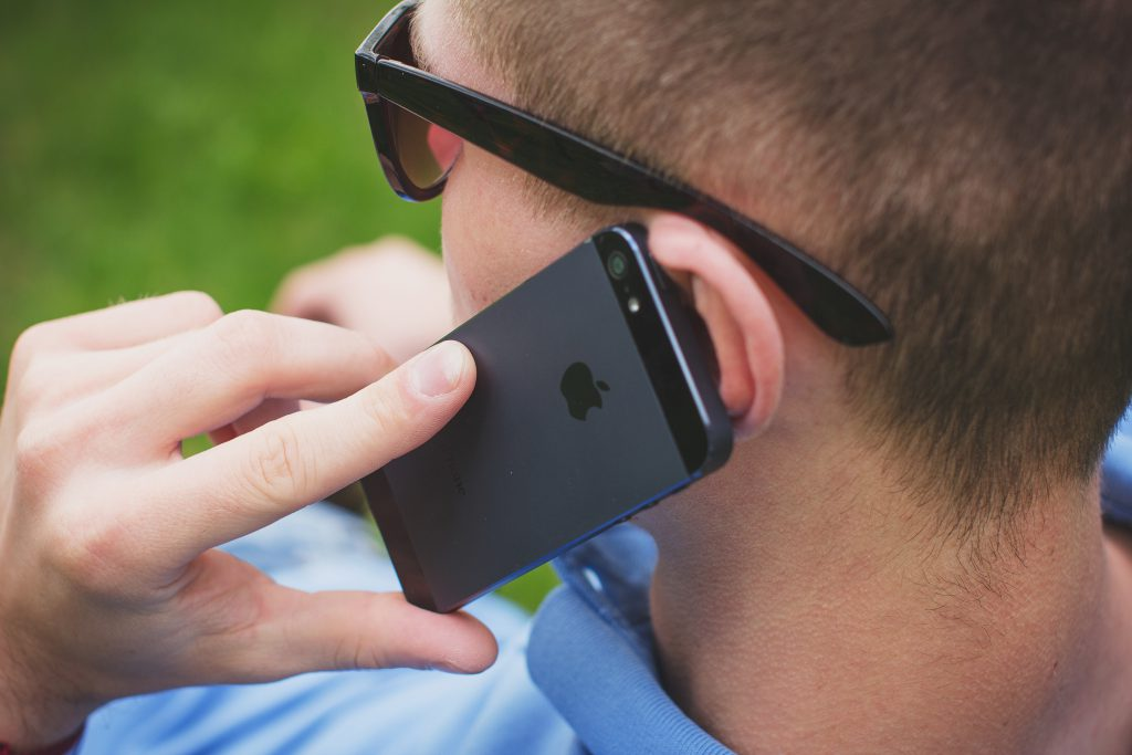 Young man talking on the phone 5 - free stock photo