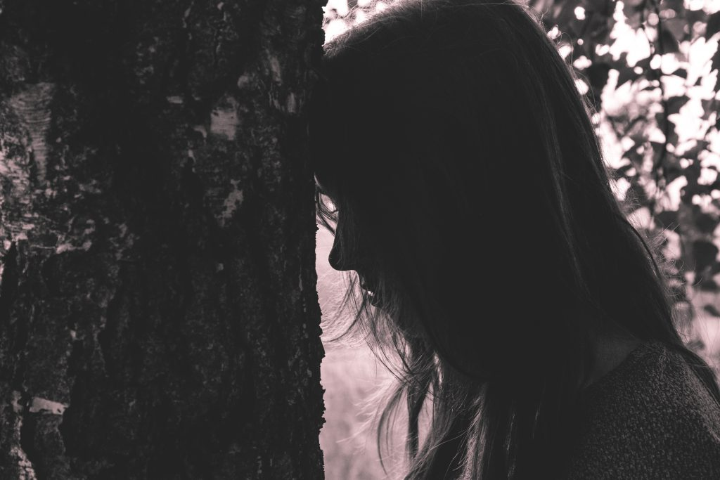 Girl leaning against the tree - free stock photo