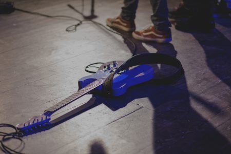 Guitar laying on the stage - free stock photo
