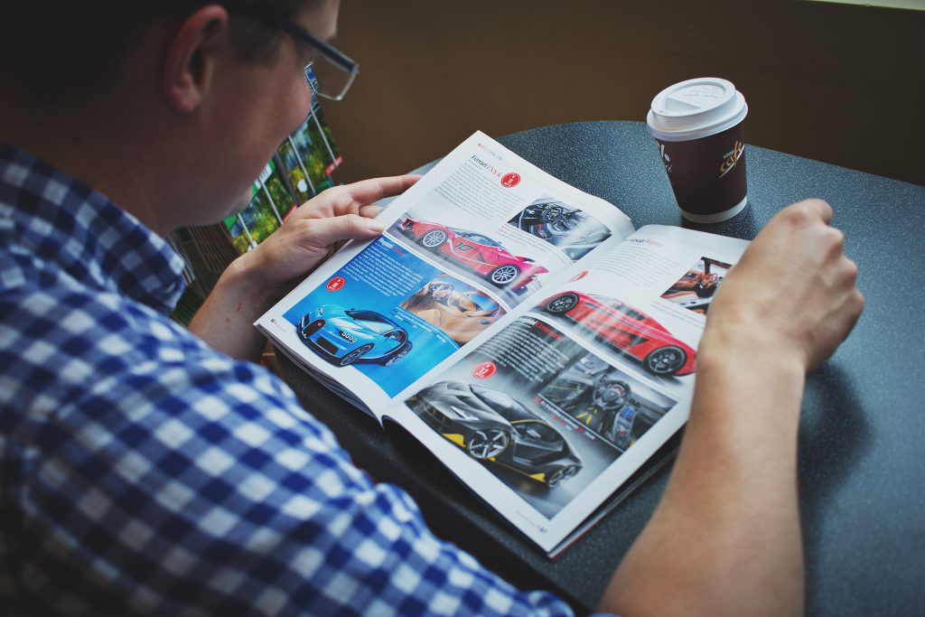 Man reading a magazine - free stock photo