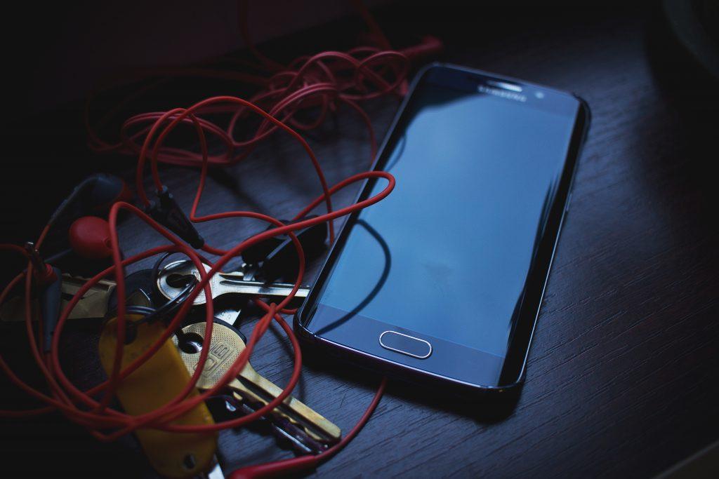 Phone, headphones and keys - free stock photo