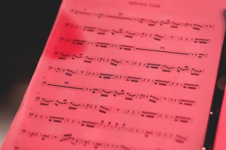 Sheet music in red light