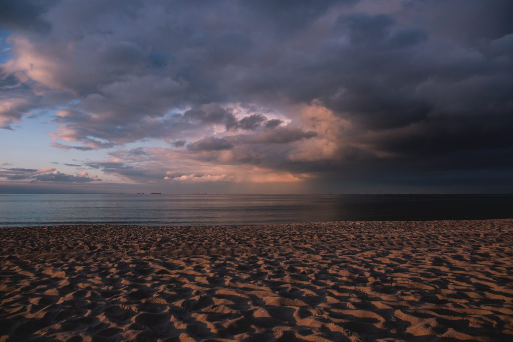 Sunny clouds at the seaside - free stock photo