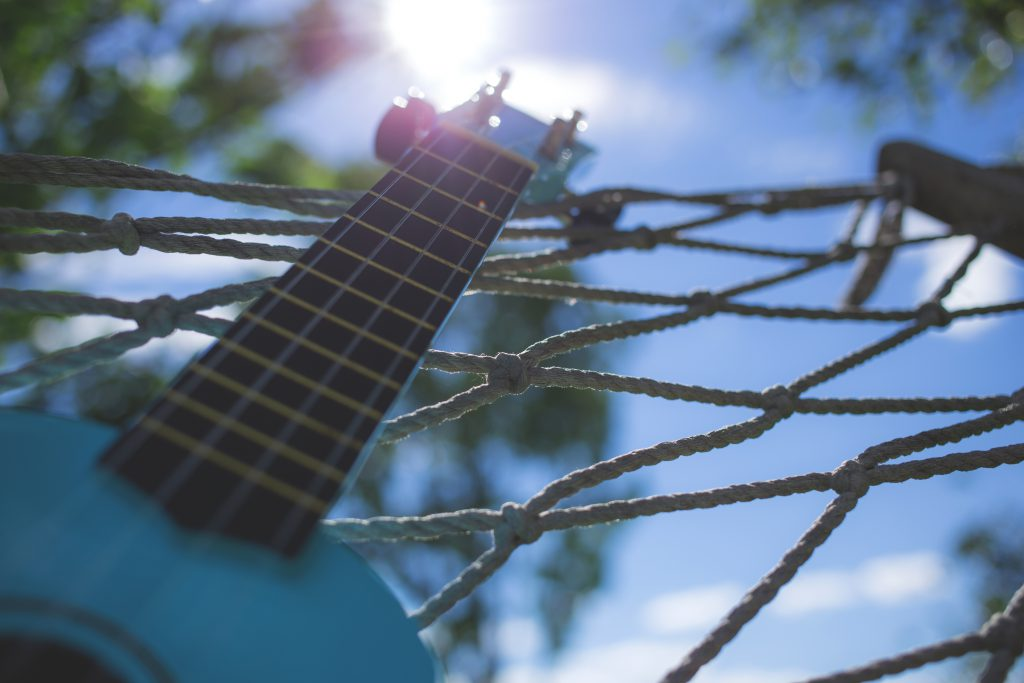 Ukulele on a hammock - free stock photo