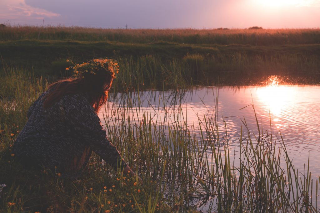 Young woman by the pond - free stock photo