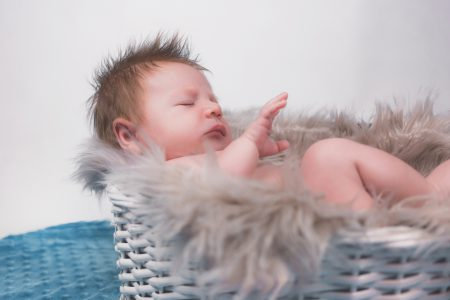 Baby in a basket - free stock photo