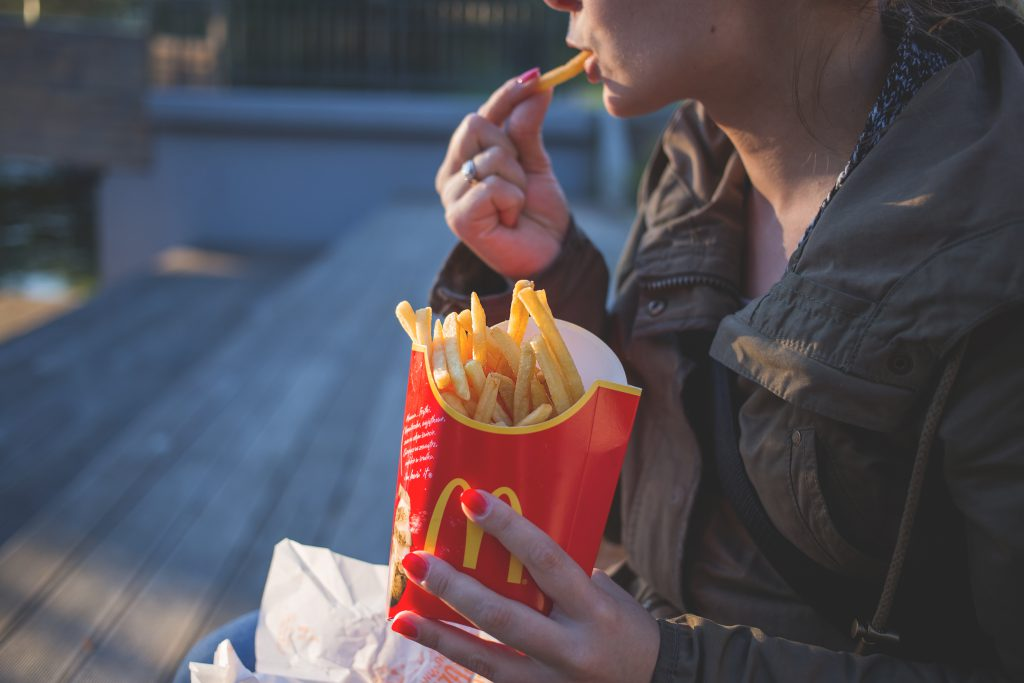 Girl eating french fries - free stock photo