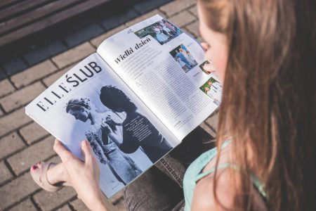 Girl reading a magazine - free stock photo