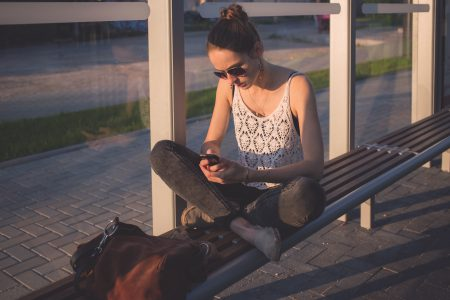 Girl sitting at tram stop - free stock photo