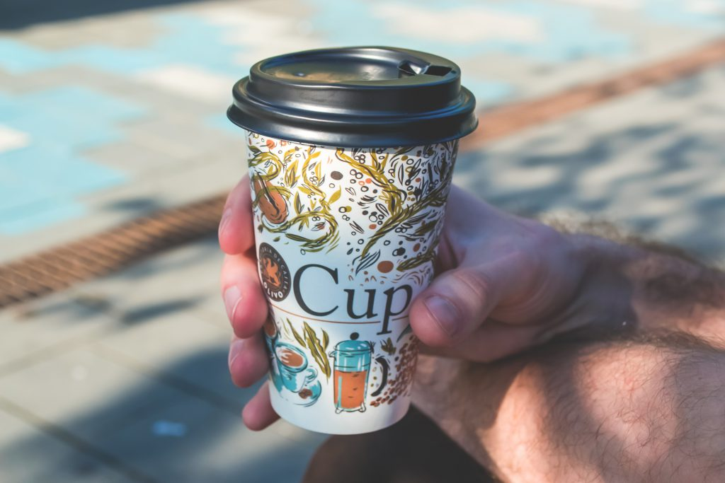 Hand holding cup of coffee - free stock photo