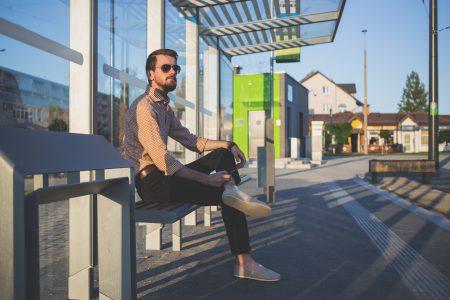 Man at tram stop