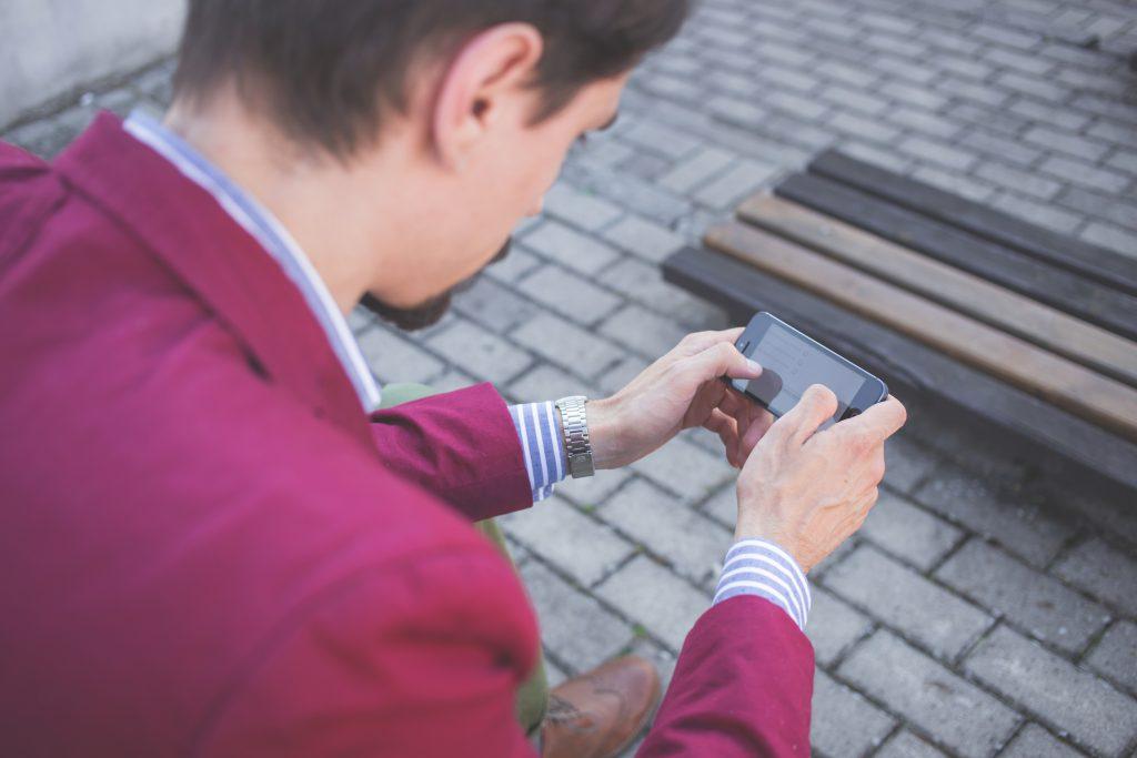Man using his phone - free stock photo