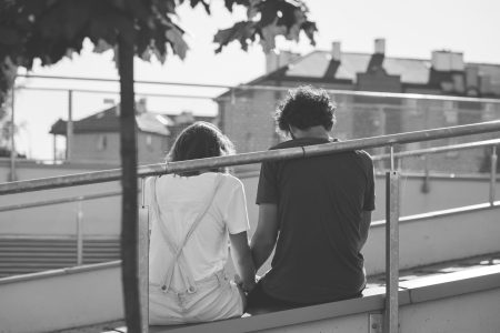 Sitting couple in black and white - free stock photo