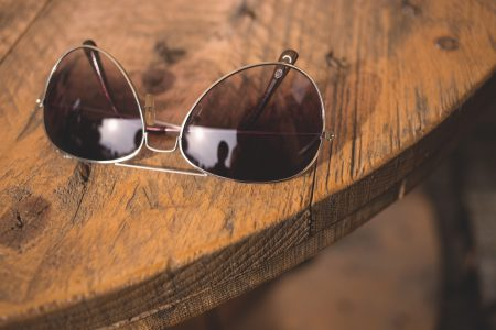 Sunglasses on a table - free stock photo