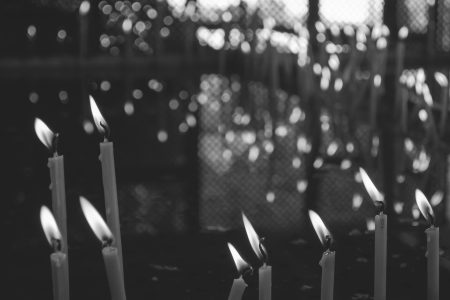 Votive candles in black and white - free stock photo