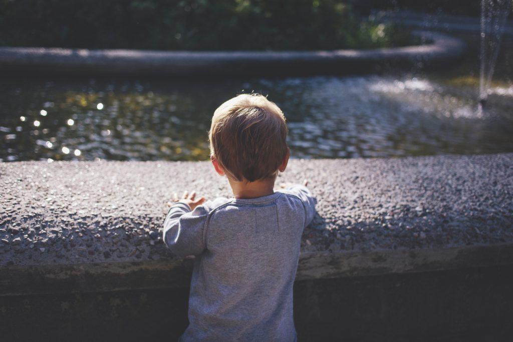 Boy at a fountain - free stock photo