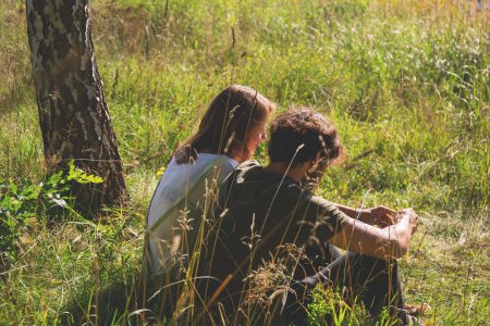 Couple sitting in the meadow - free stock photo