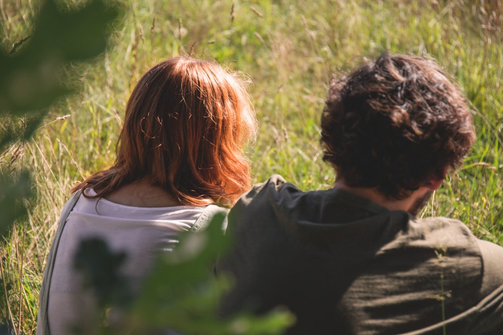 Couple sitting in the meadow 2 - free stock photo