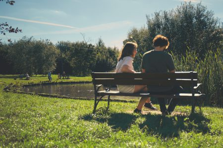 Couple sitting on a bench - free stock photo