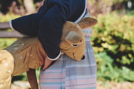 A girl holding plush Bambi - free stock photo