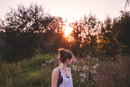 Girl looking back at sunset - free stock photo