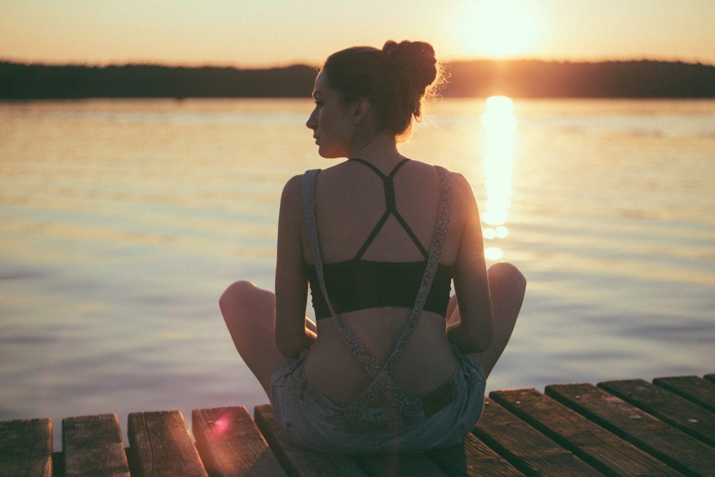 Girl sitting on a pier - free stock photo