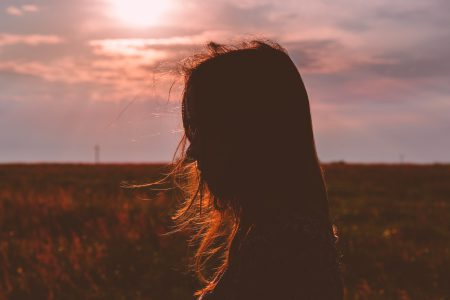 Girl's head silhouette at sunset - free stock photo