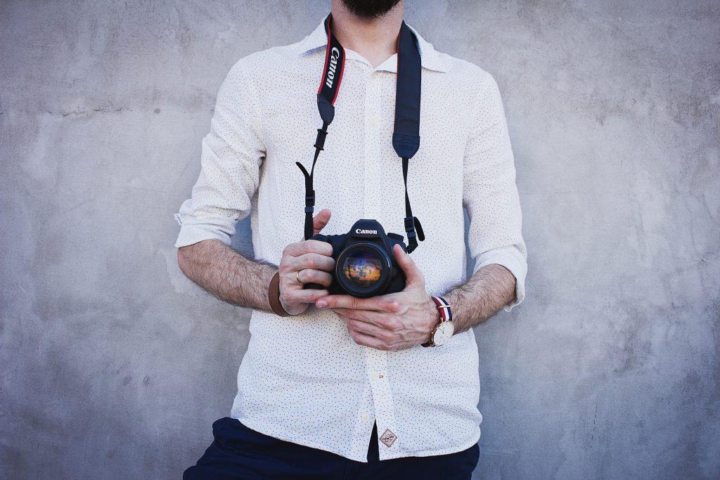 Man holding a camera - free stock photo