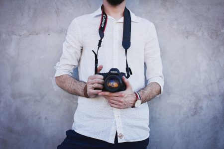 Man holding a camera - free stock photo