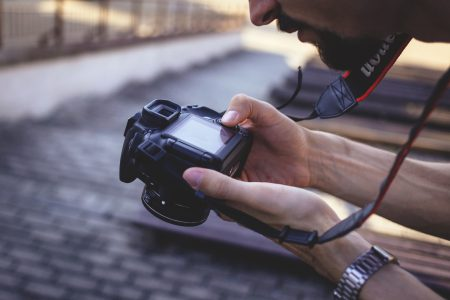 Man holding a camera 2 - free stock photo