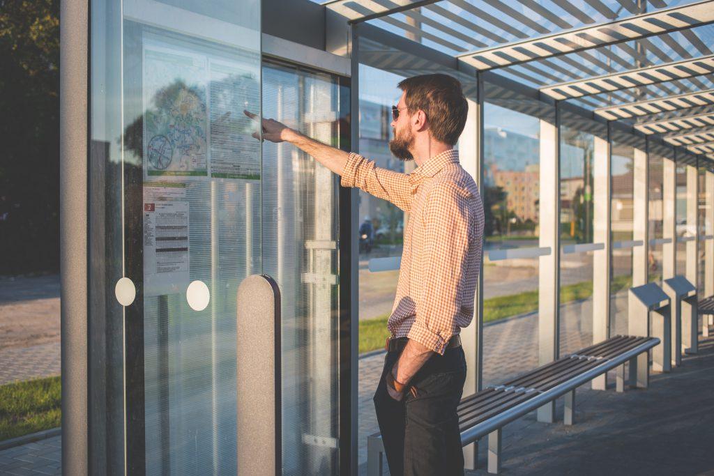 Man standing at tram stop - free stock photo