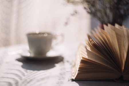 Open book and a cup of tea - free stock photo