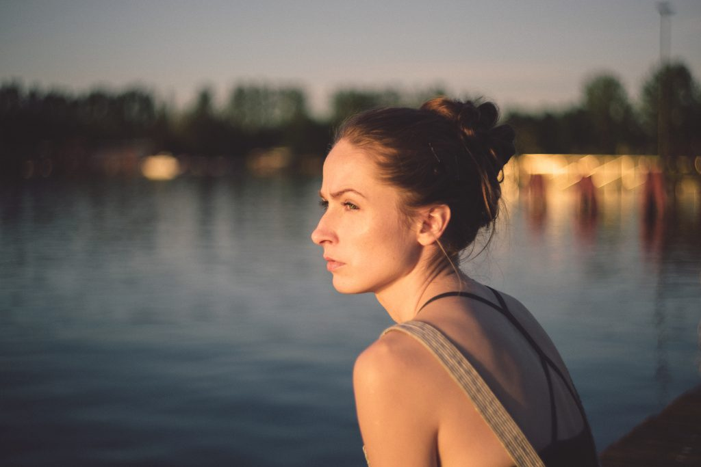 Pensive girl at the lake - free stock photo