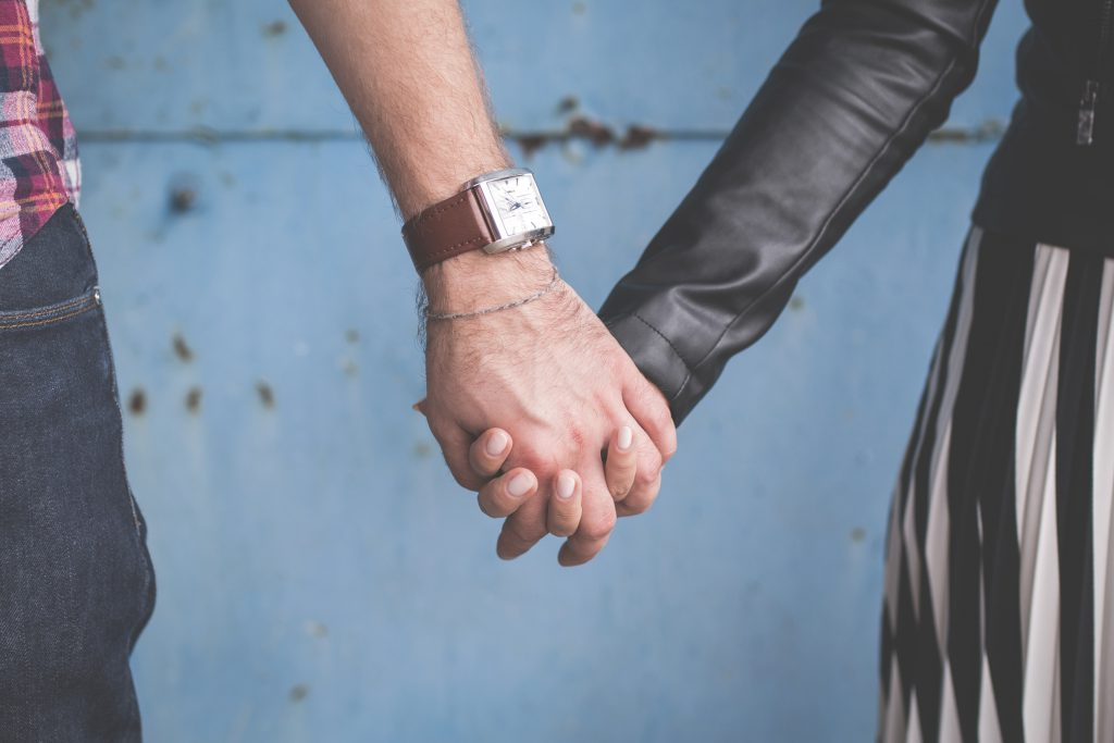 Standing couple holding hands - free stock photo