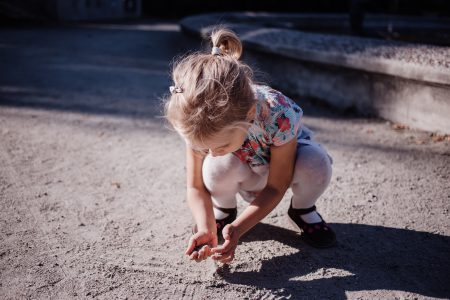 Girl playing with sand - free stock photo