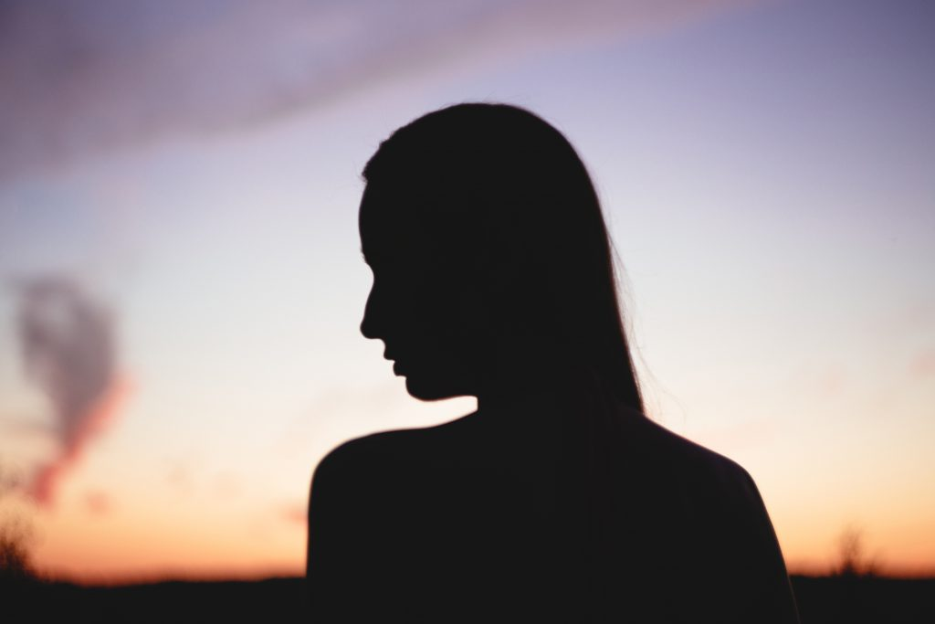 Girl's head silhouette at sunset 2 - free stock photo