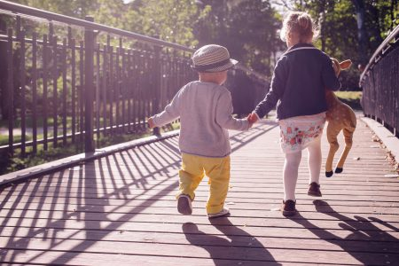 Kids running across the bridge - free stock photo