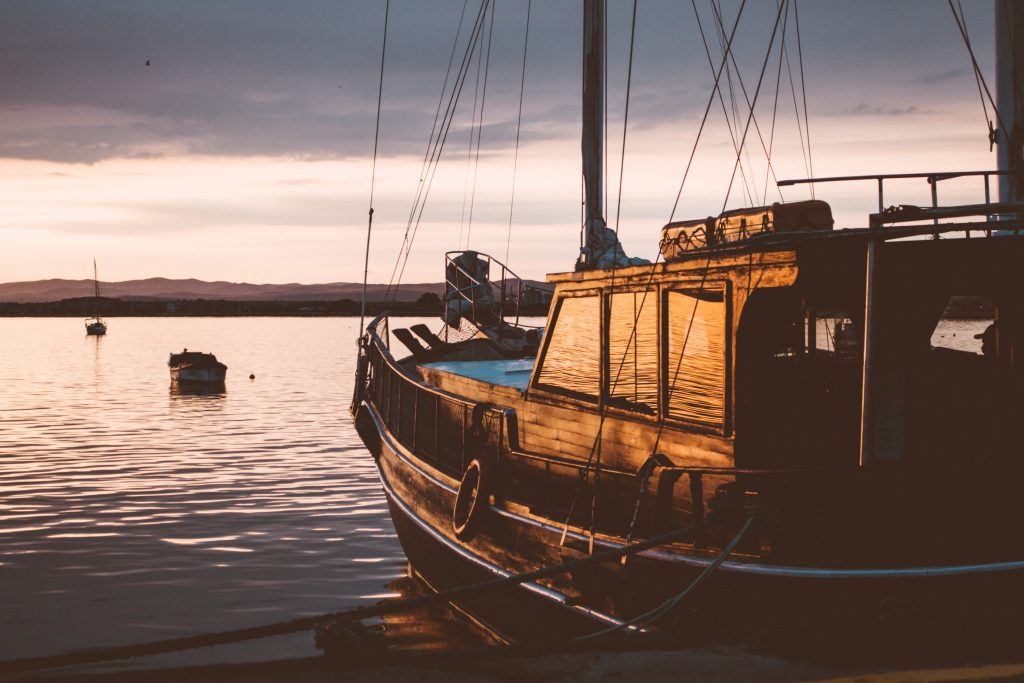 A sailing boat at sunset - free stock photo